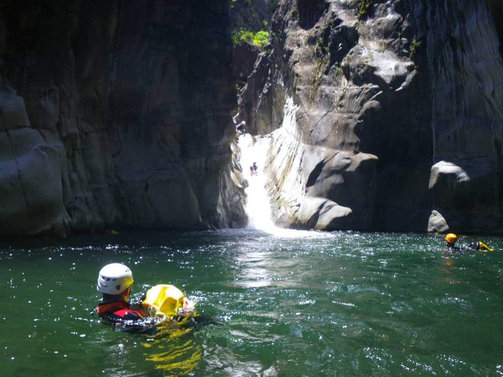 Canyoning in Trou blanc canyon, Reunion island, with a canyoning guide