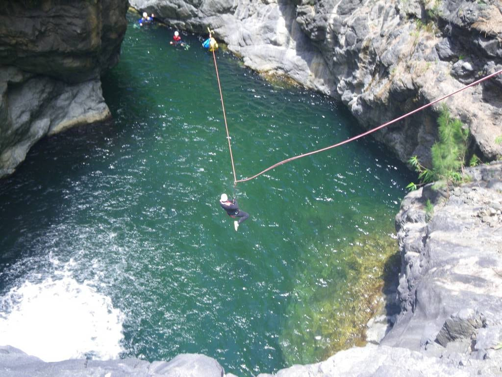 Final zip line in Trou blanc canyon, Reunion island, with an ADVENTURES REUNION canyoning guide