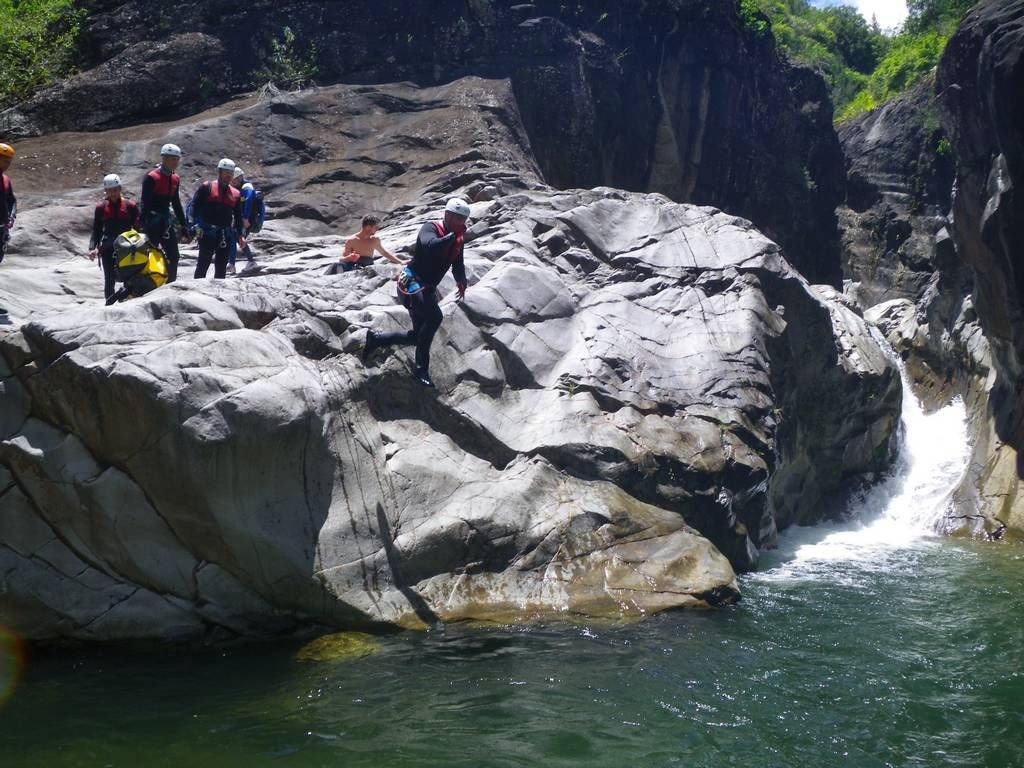 A jump in Trou blanc canyon, Reunion island, with an ADVENTURES REUNION canyoning guide